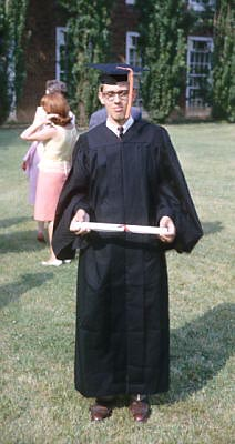 1965 Doc Holds Diploma, photo credit unknown.